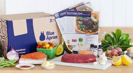 Blue Apron meal kit ingredients on a table